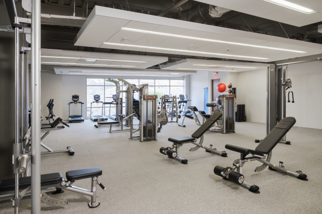 Full fitness center with spa-like locker rooms, showers, WiFi and water station
